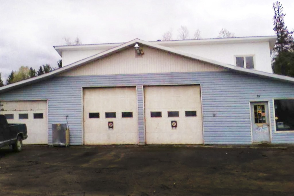 the front of a mechanic garage with two doors